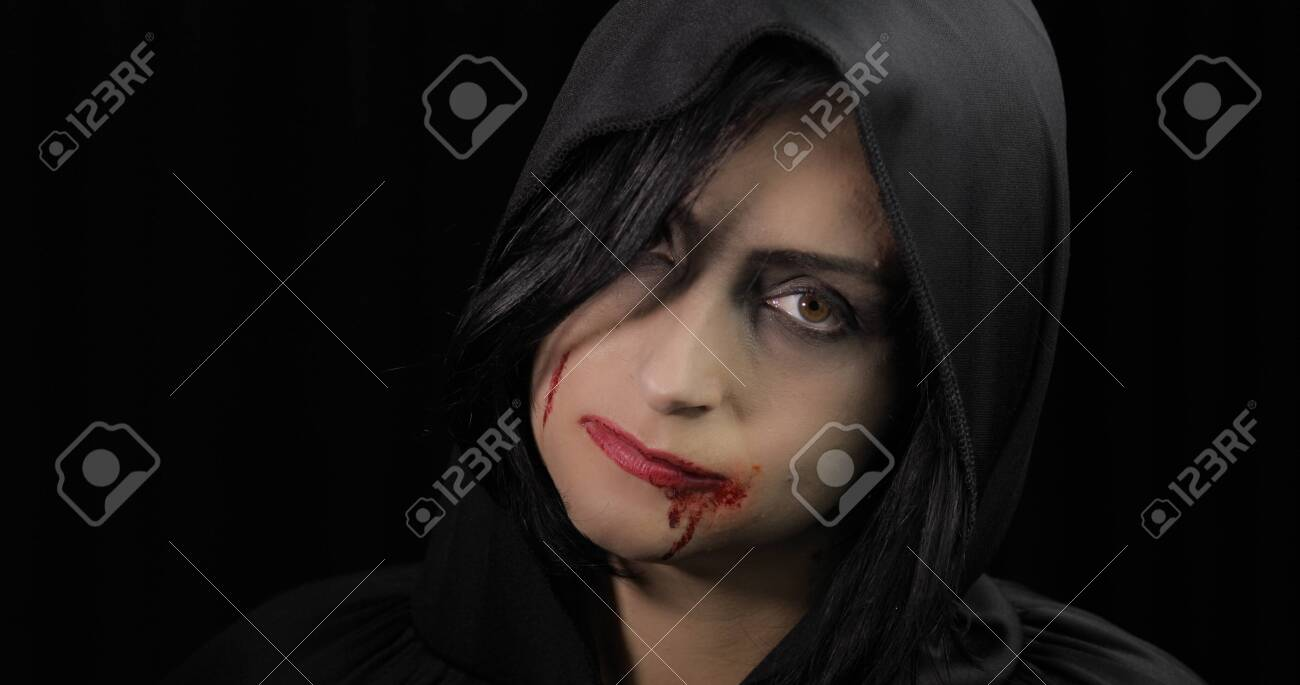 Vampire Halloween woman portrait. Beauty sexy Vampire girl with..