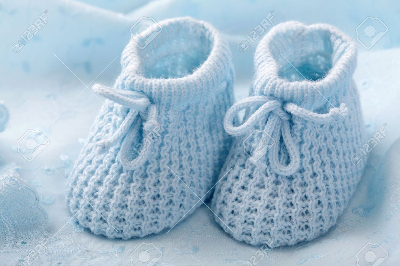 9682621469ac Blue baby booties on blue background Stock Photo - 10818254