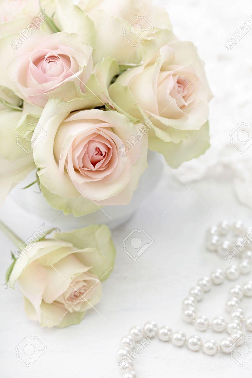 White roses in a vase on white background - 12879082