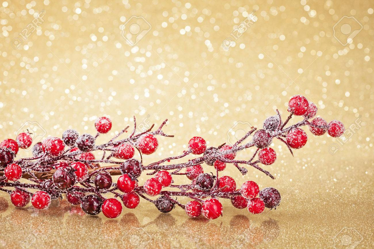 Branch wit red berries on a golden background - 23195093