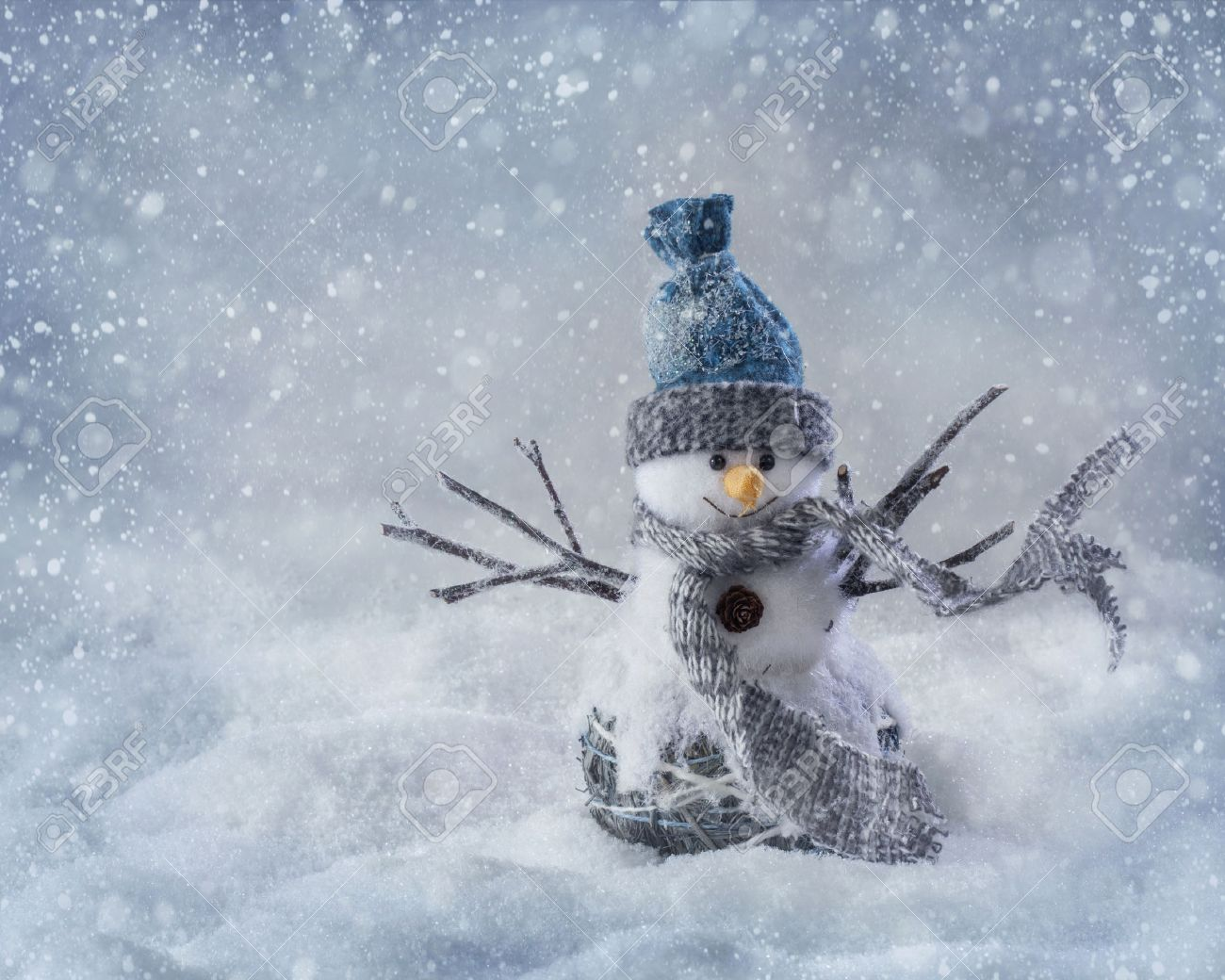 Smiling snowman standing in the snow - 23448383