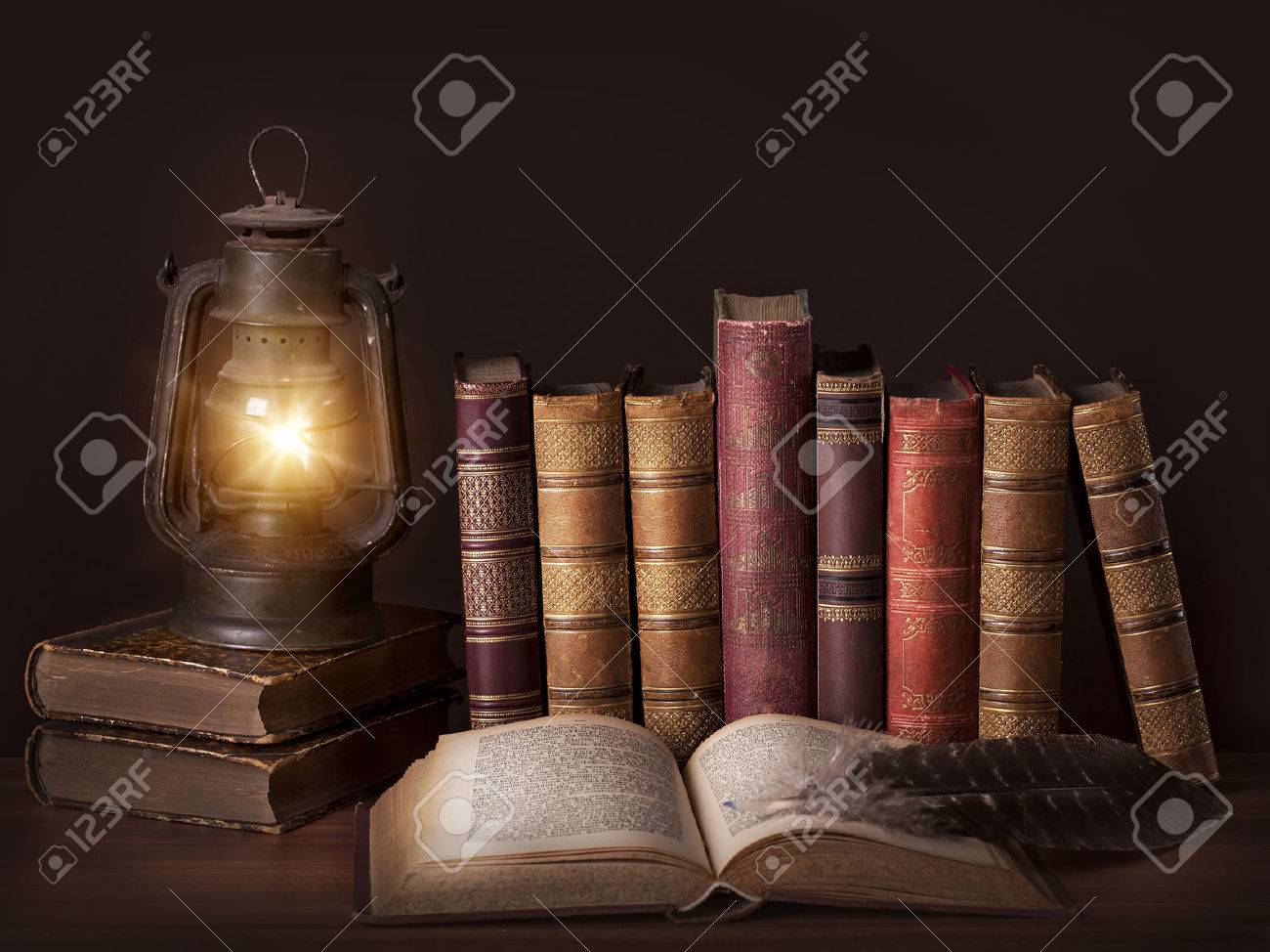 Old Vintage Books Standing In A Row And An Old Lamp Stock Photo   23917093