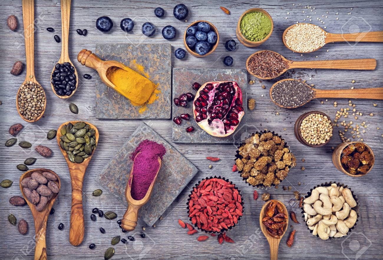 Super foods in spoons and bowls on a wooden background - 54145201