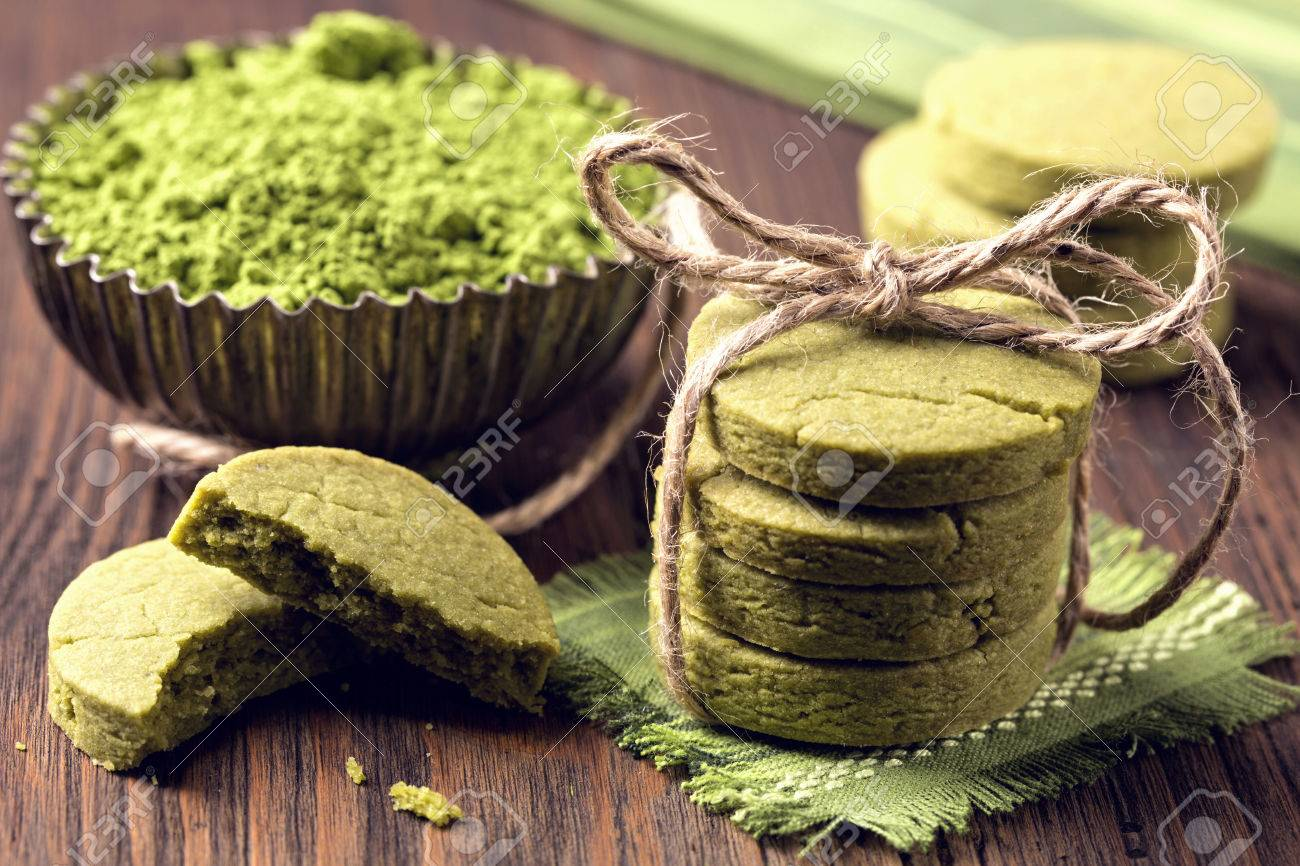 Matcha green tea cookies on a wooden table - 56152466
