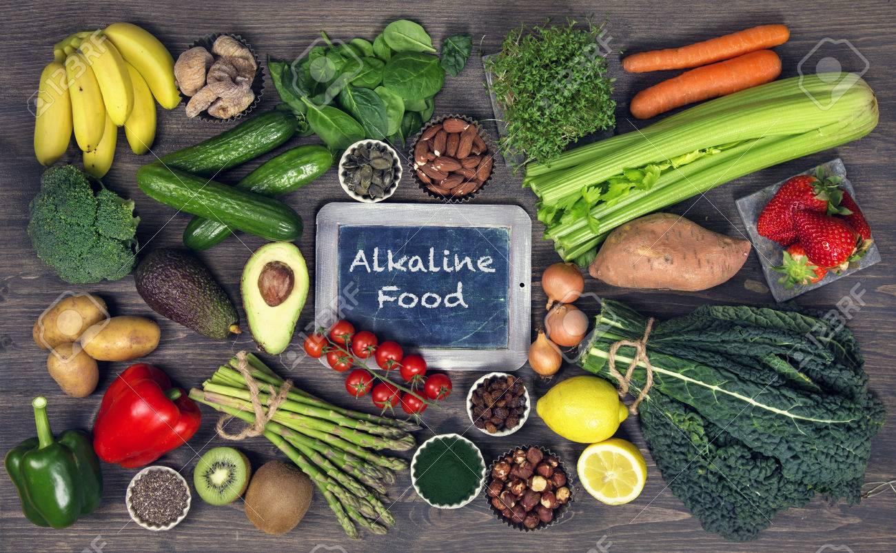 Alkaline foods above the wooden background - 74544238