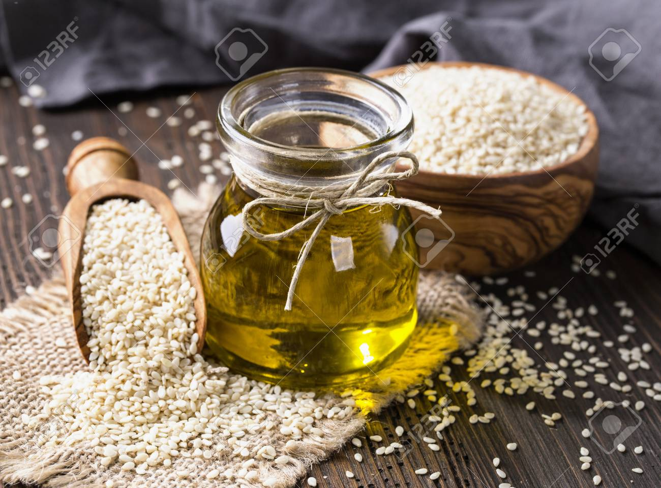 Sesame oil in glass and seeds - 81193429