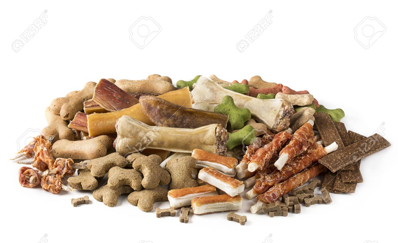 Assortment of dog snacks isolated on a white background - 94746595