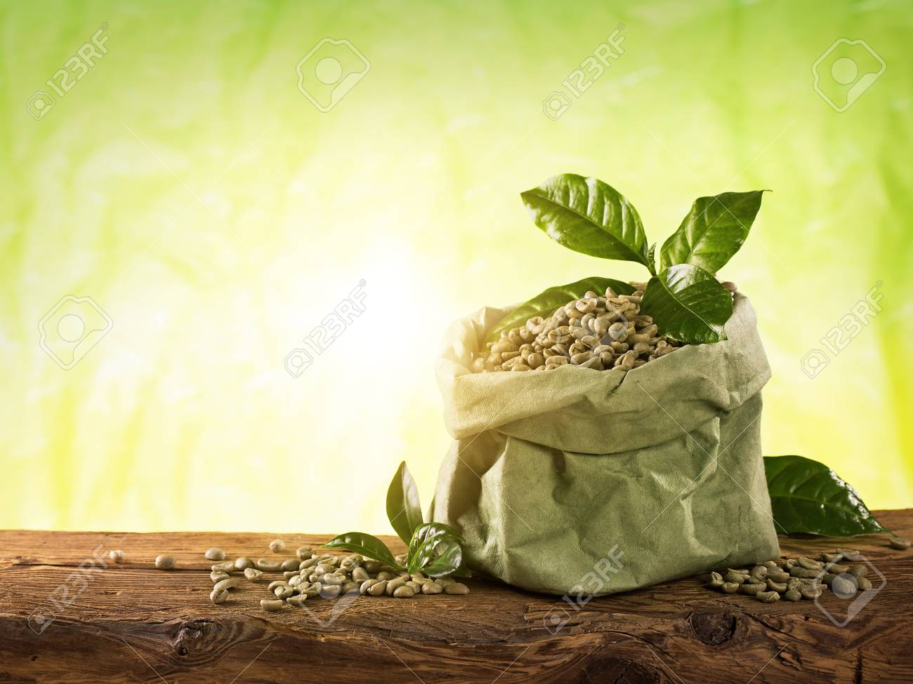 Green Coffee Beans On A Green Background Stock Photo Picture And