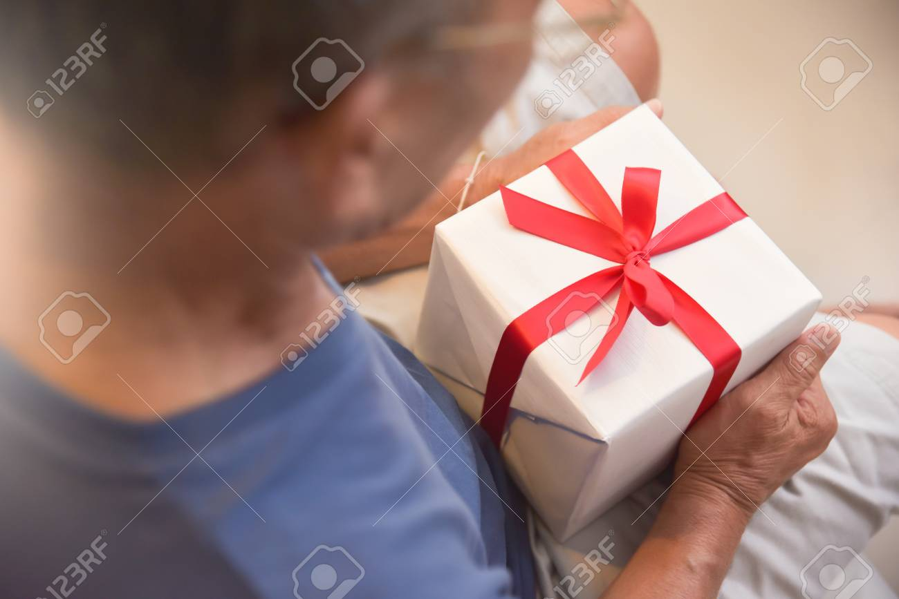 Happy Asian Elderly Man Holding A White Gift Box Birthday Christmas And New Year