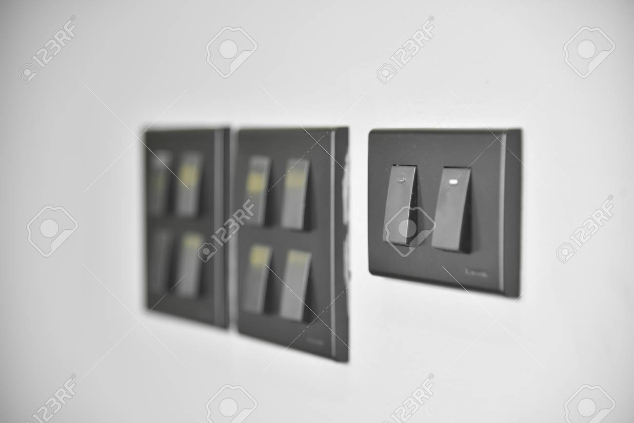 Close Up Grey Or Black Lighting Switches On White Wall Background ...