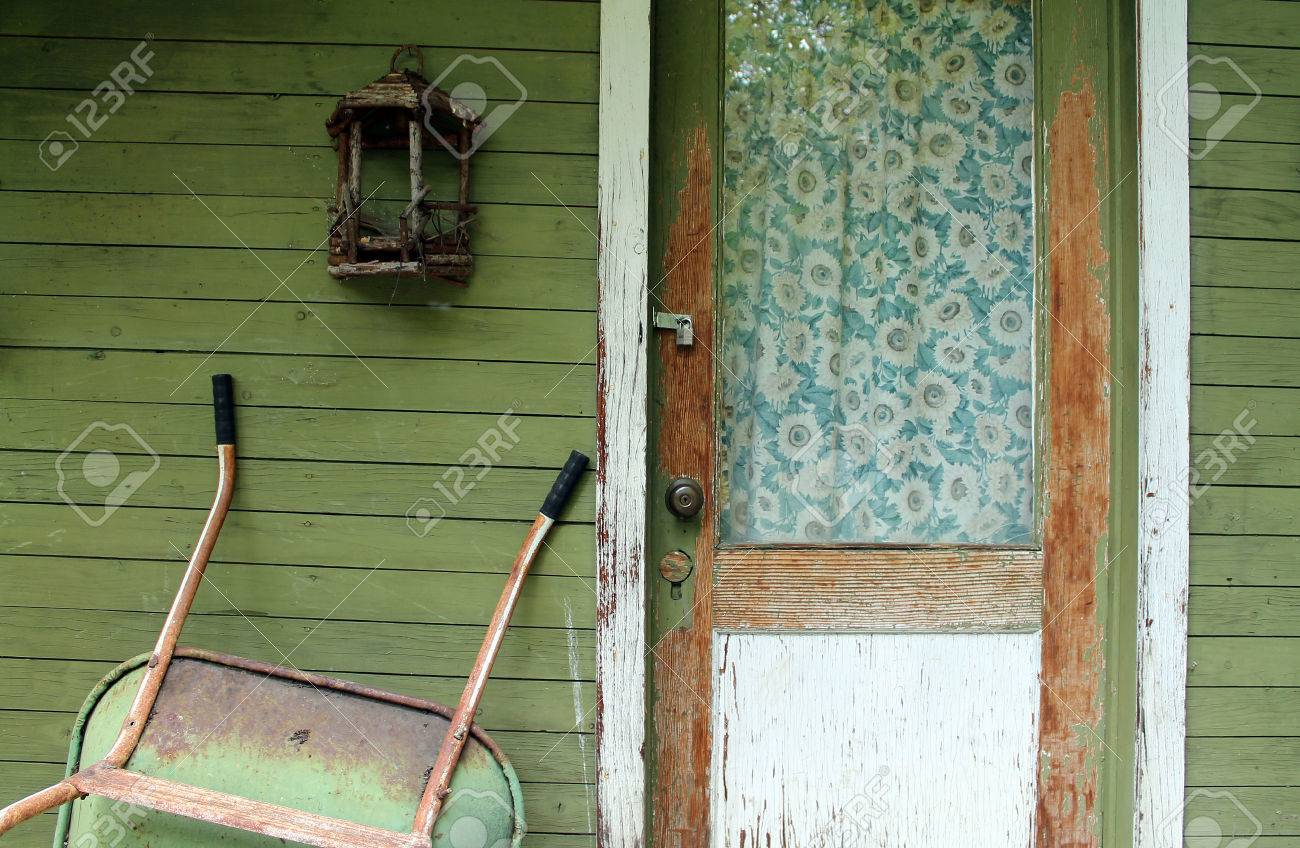 Weathered Front Door With Vintage Curtains On A Green Wooden Stock Photo Picture And Royalty Free Image Image 68712248