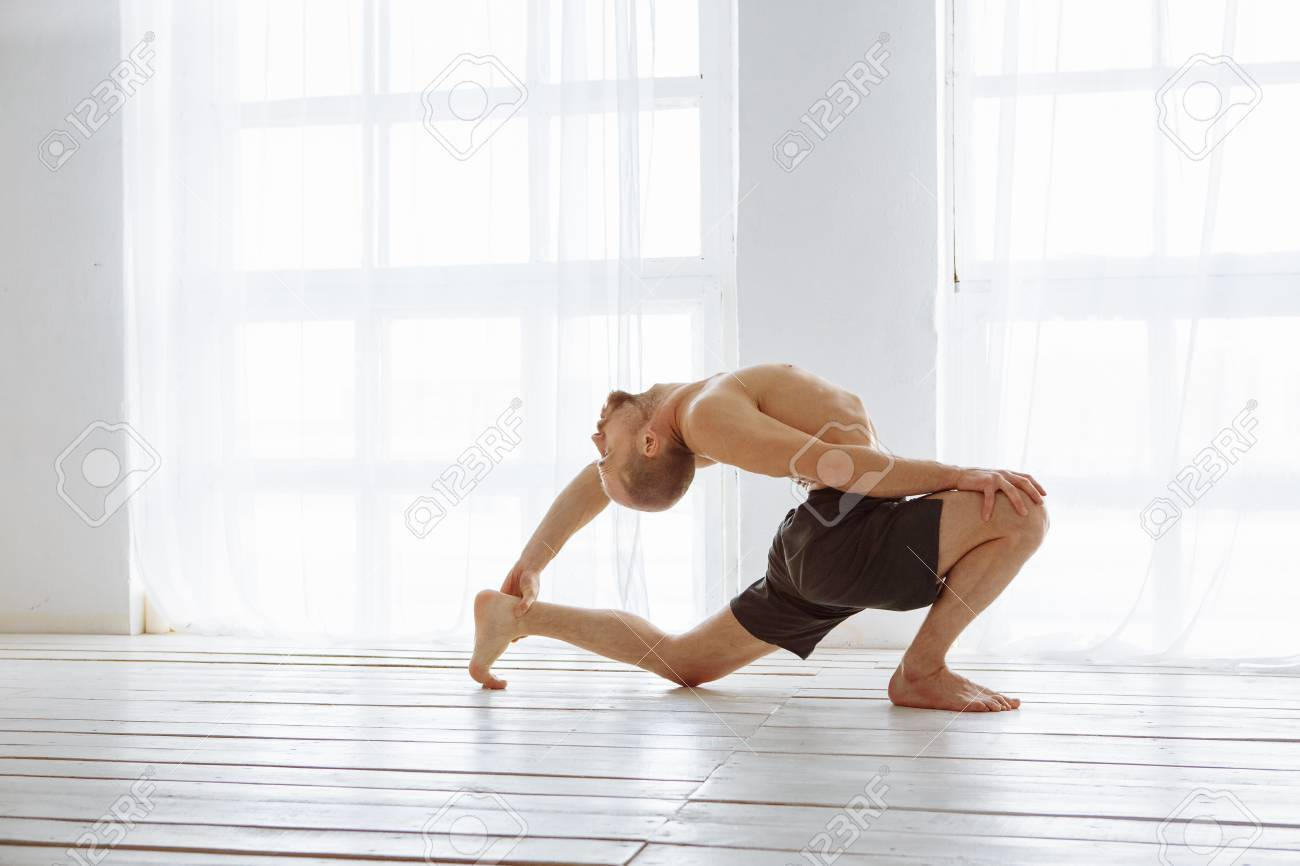 Man Practicing Advanced Yoga A Series Of Yoga Poses Lifestyle Stock Photo Picture And Royalty Free Image Image 72143124