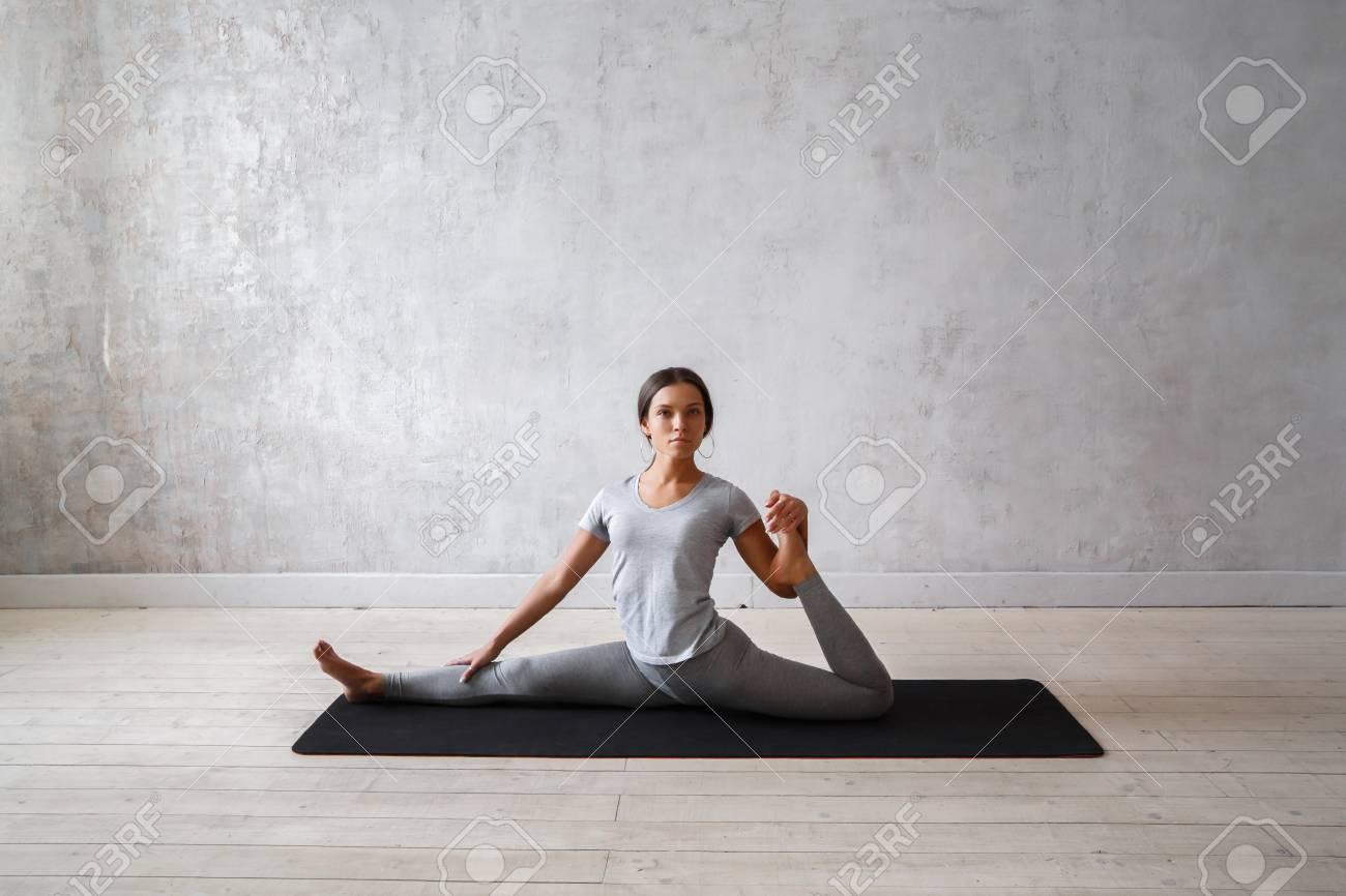Woman Practicing Advanced Yoga A Series Of Yoga Poses Stock Photo Picture And Royalty Free Image Image 74744041