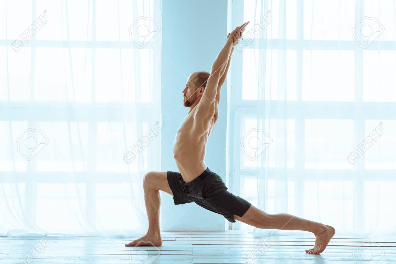 Man Practicing Advanced Yoga A Series Of Poses Lifestyle Concept Stock Photo