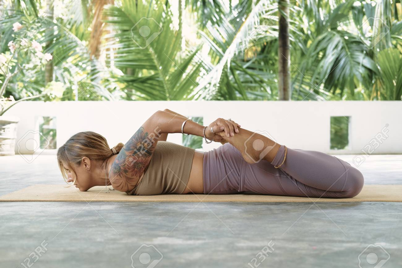 Woman Practicing Advanced Yoga On Organic Mat Series Of Yoga Stock Photo Picture And Royalty Free Image Image 122896993