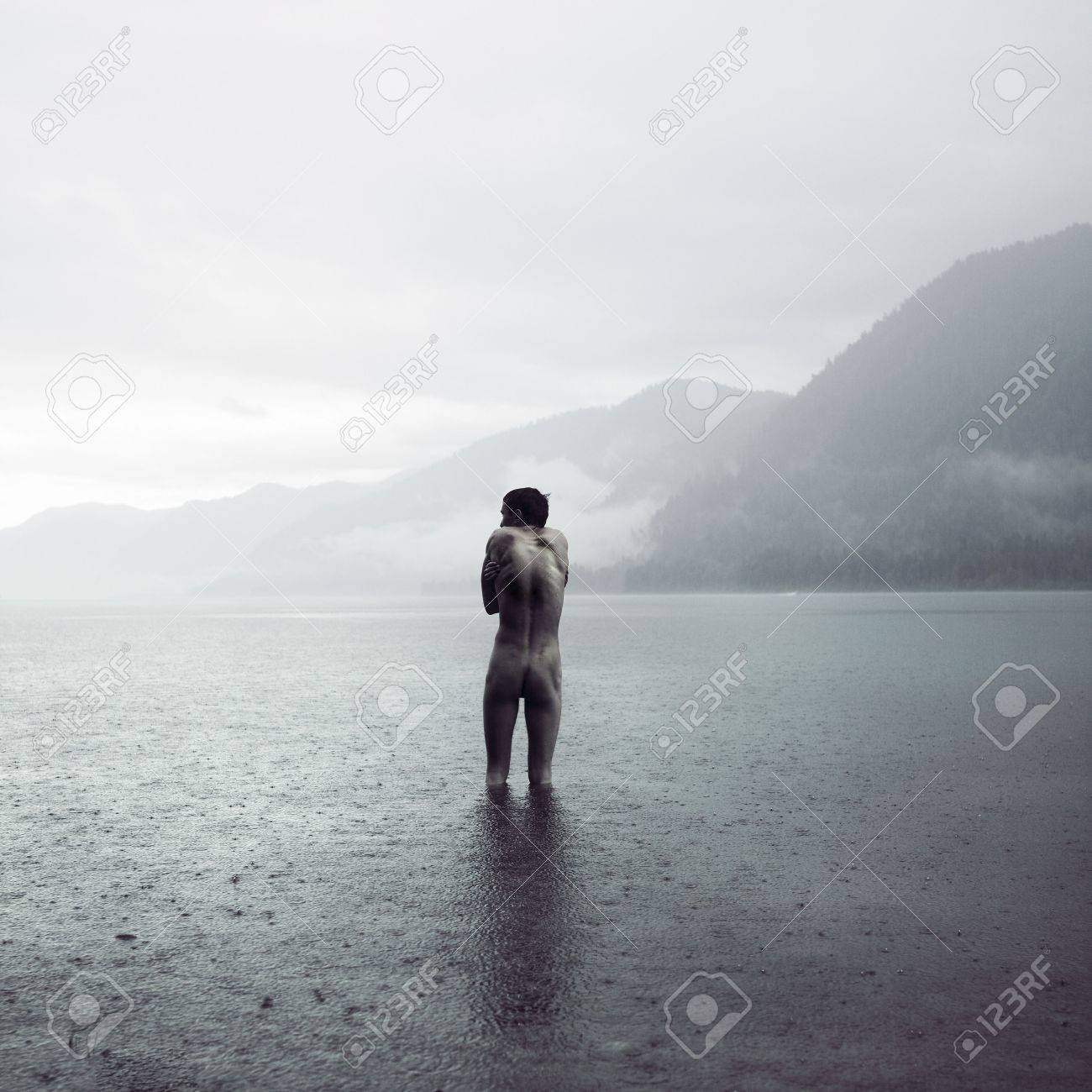 Picturesque landscape. Young man in lake - 5384172