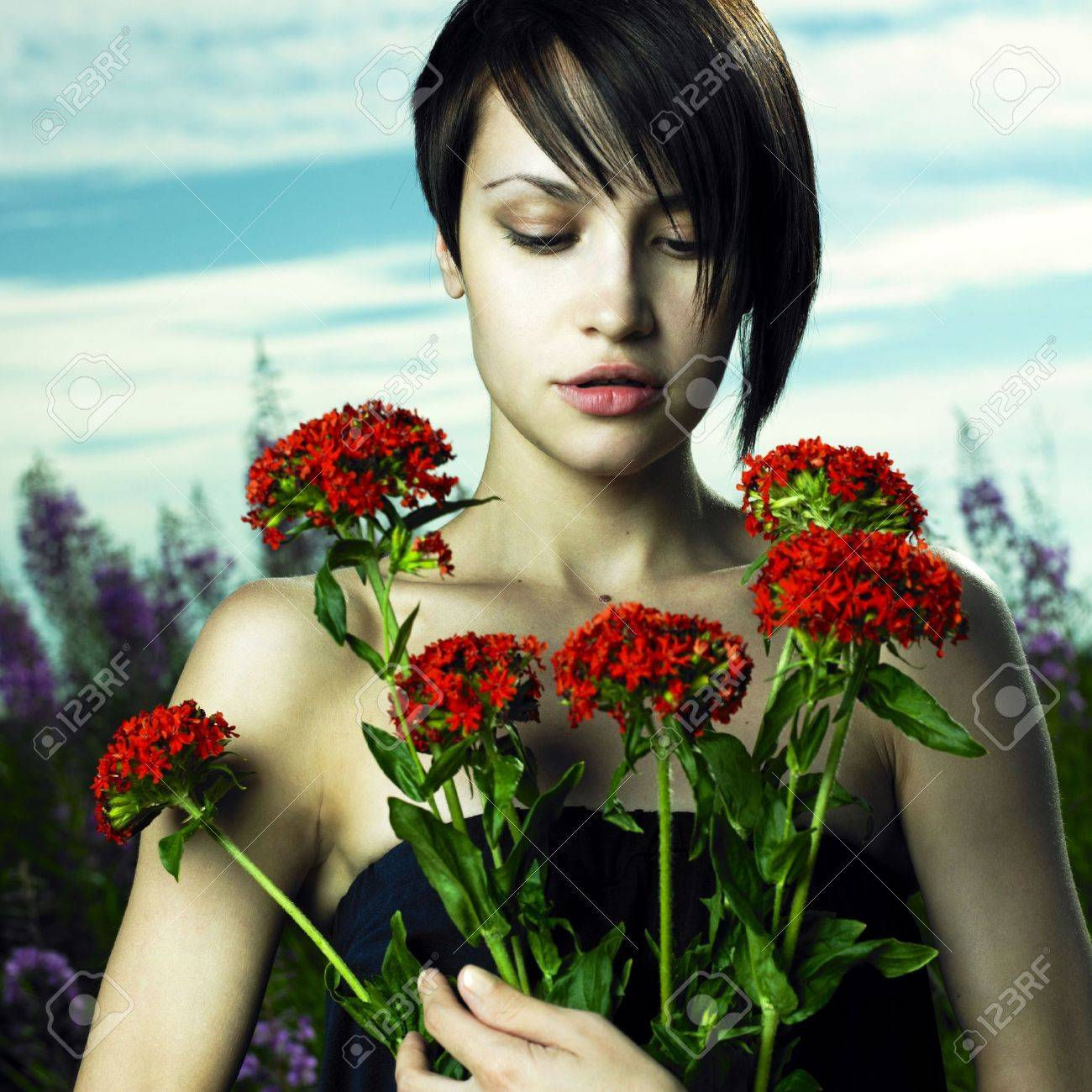 Portrait of romantic girl in flower meadow Stock Photo - 8105849