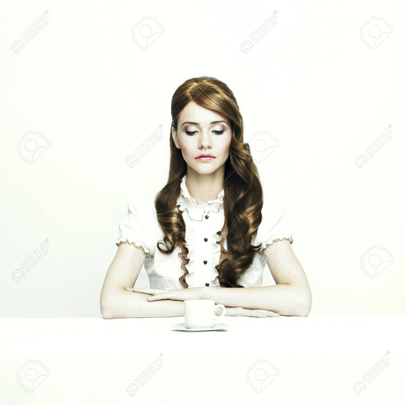 Portrait of a beautiful elegant lady at white table Stock Photo - 8454134