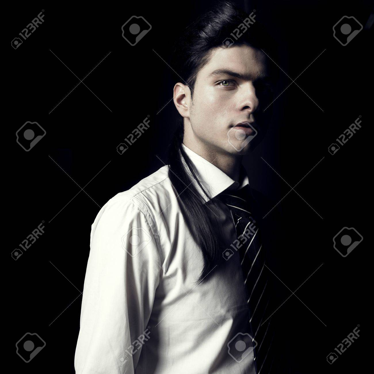 Portrait of handsome stylish men looking out of the darkness Stock Photo - 8479000