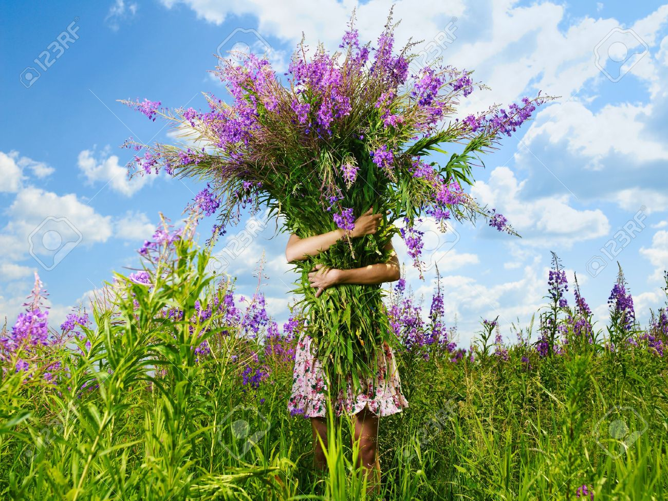 A Girl With A Giant Bouquet Of Flowers Stock Photo, Picture And ...