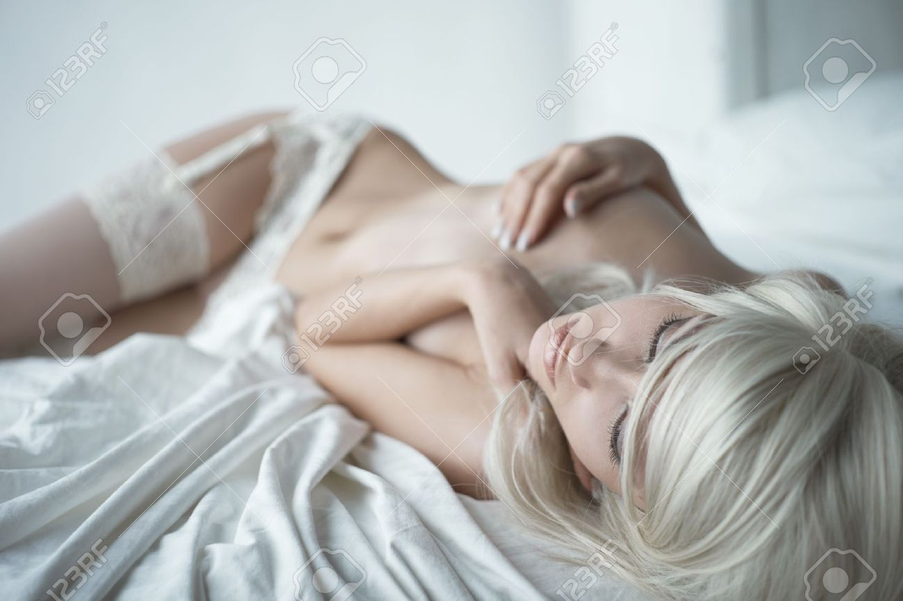 Fashion portrait of young elegant woman in bed Stock Photo - 11535143