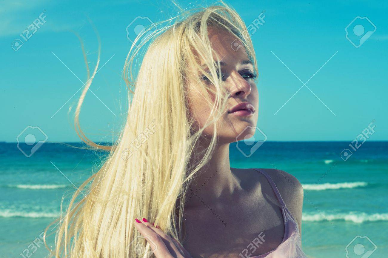 Photo of beautiful young blonde at blue sea Stock Photo - 12376747