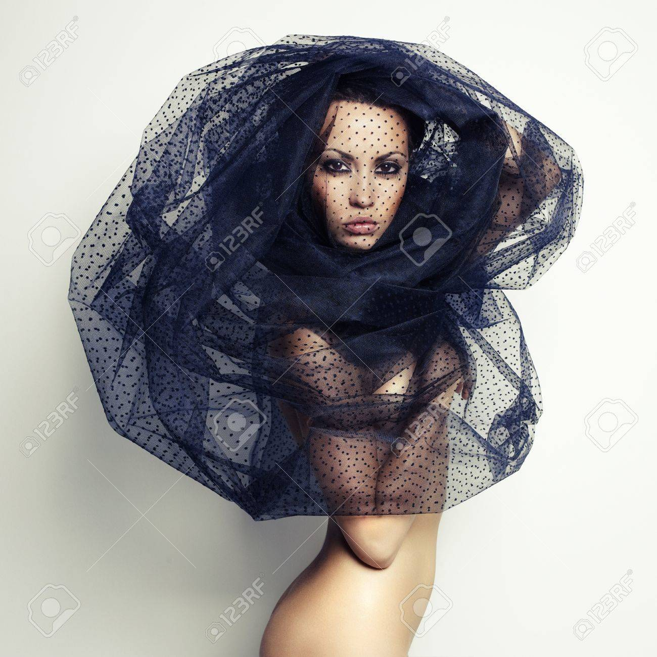 Sensual beautiful woman under the black veil Stock Photo - 16084593