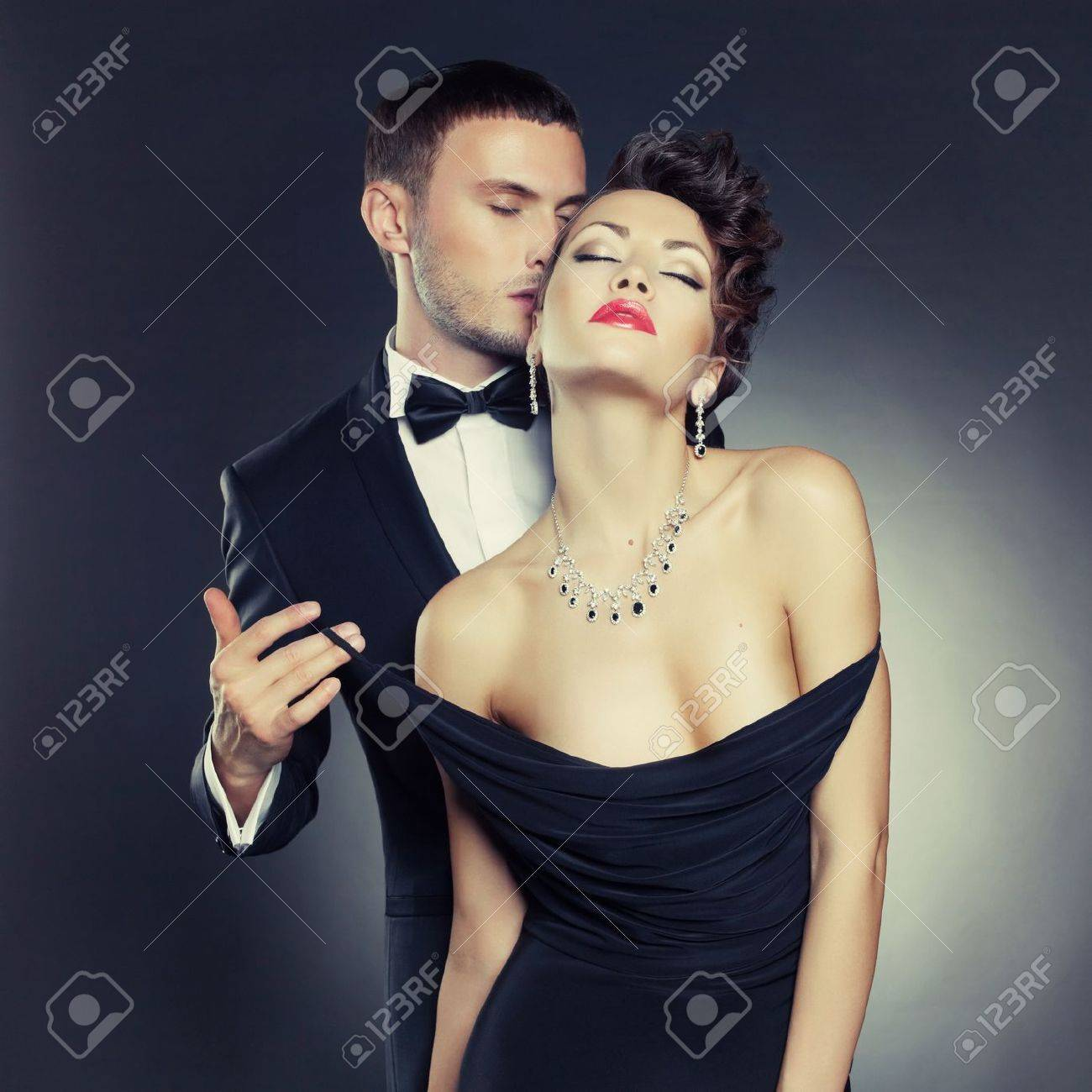 Fashion photo of sexy elegant couple in the tender passion Stock Photo - 17625963