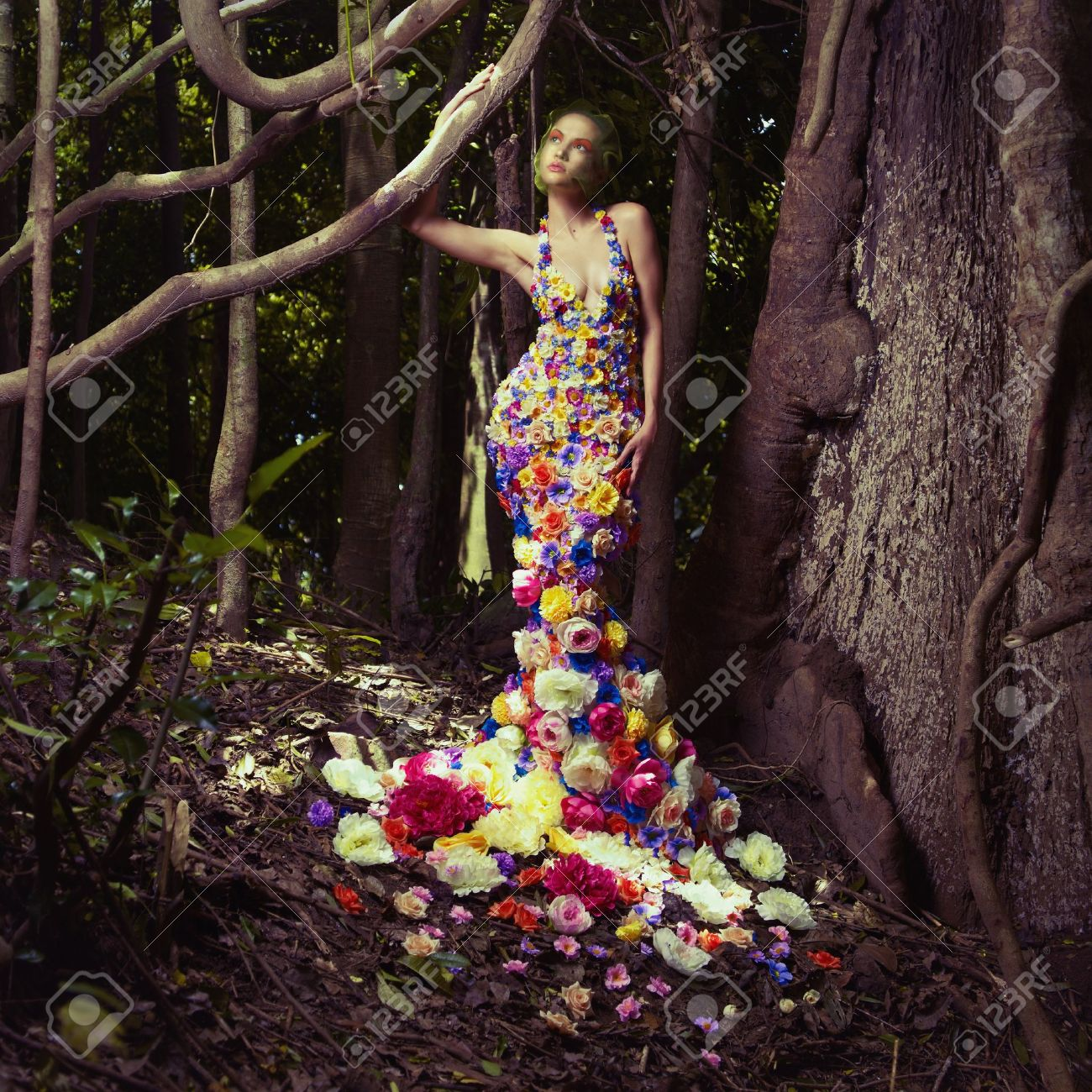 Blooming gorgeous lady in a dress of flowers in the rainforest Stock Photo - 17625971