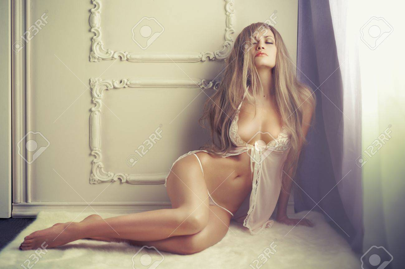 Fashion art of young sensual lady in classical interior Stock Photo - 18381782