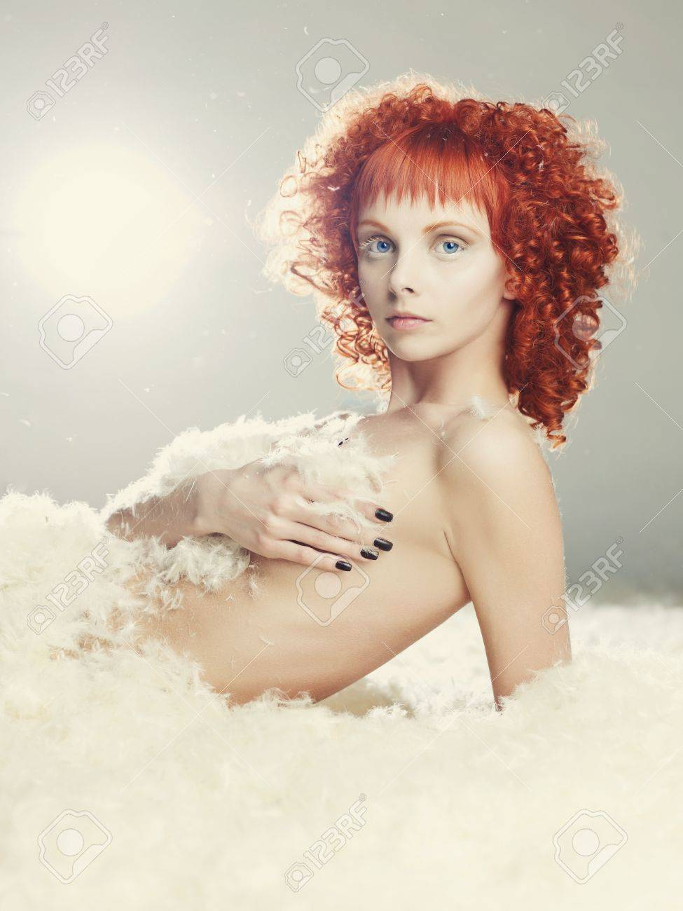 Portrait of a young angelic woman with red hair Stock Photo - 18809909