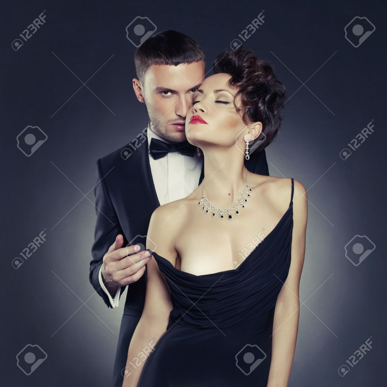 Fashion photo of sexy elegant couple in the tender passion Stock Photo - 18809908