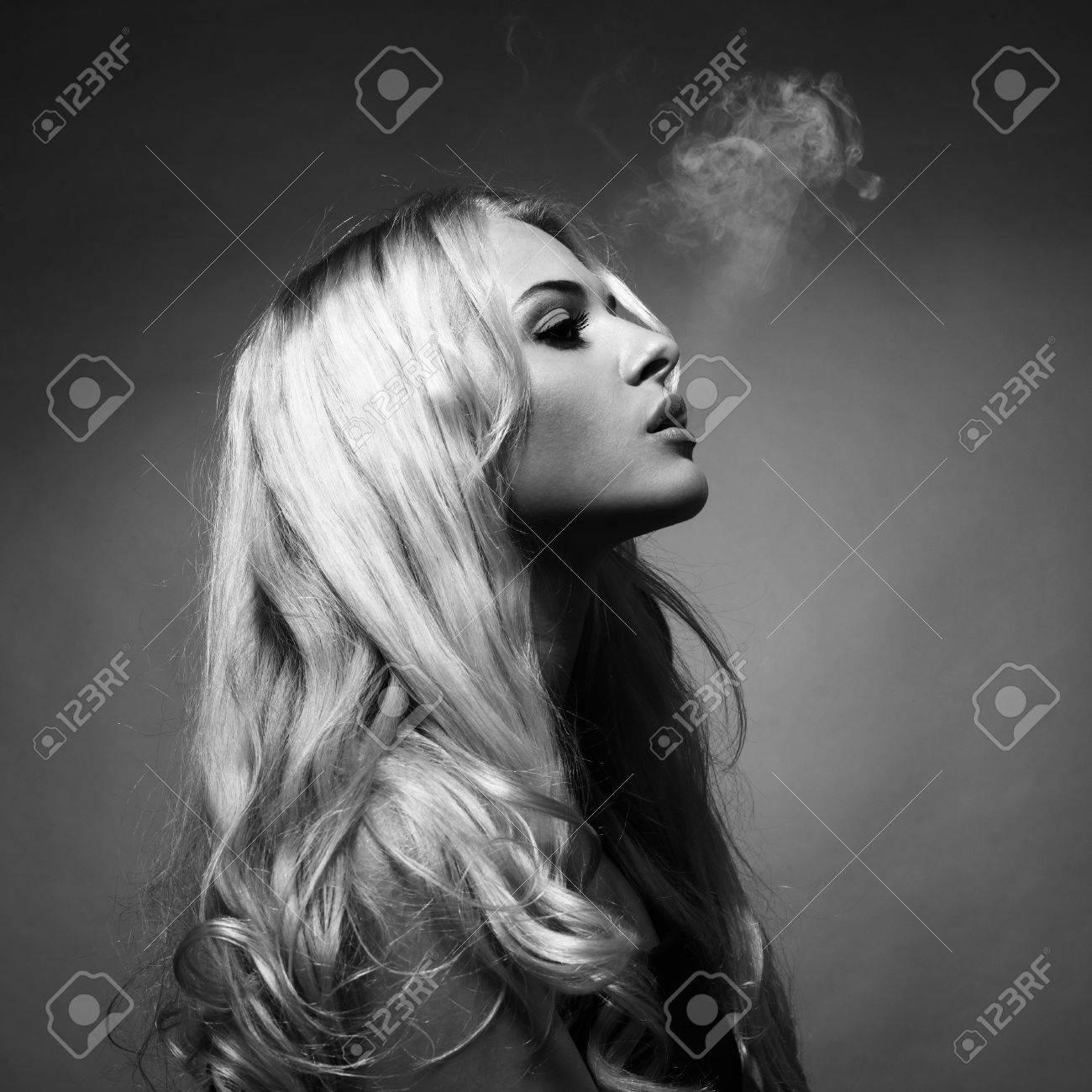 Fine art portrait of a beautiful lady smokes Stock Photo - 21512350