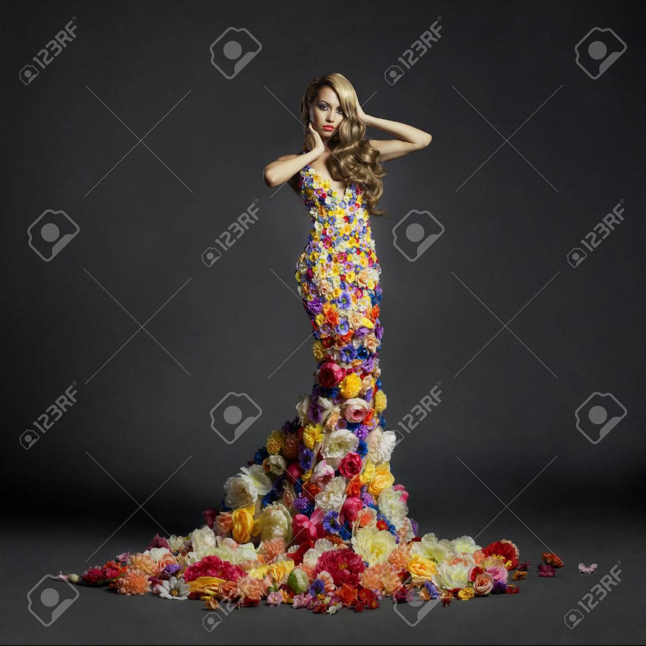 Studio portrait of blooming gorgeous lady in dress of flowers Standard-Bild - 32937293