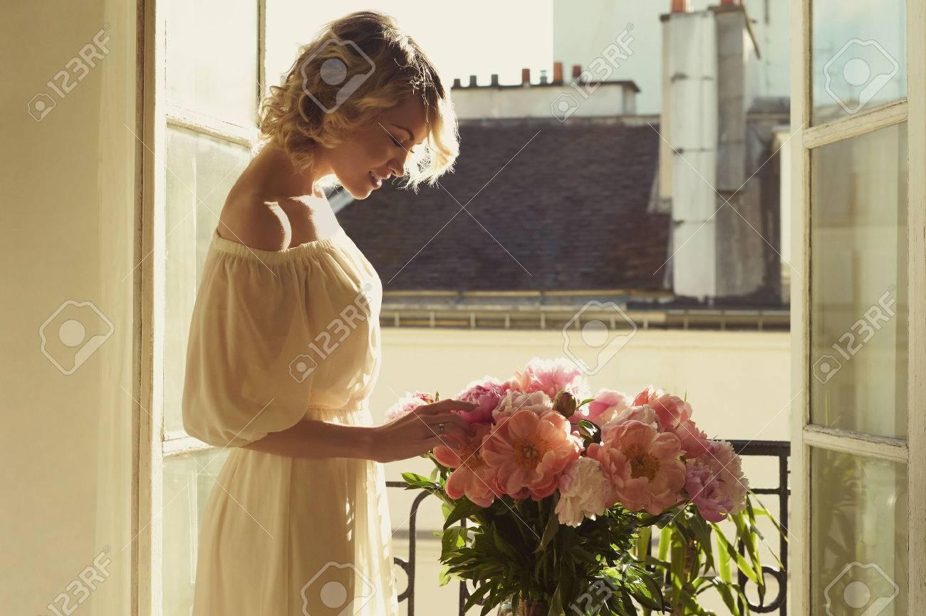 Fashion art portrait of beautiful blonde at the window Standard-Bild - 33002145