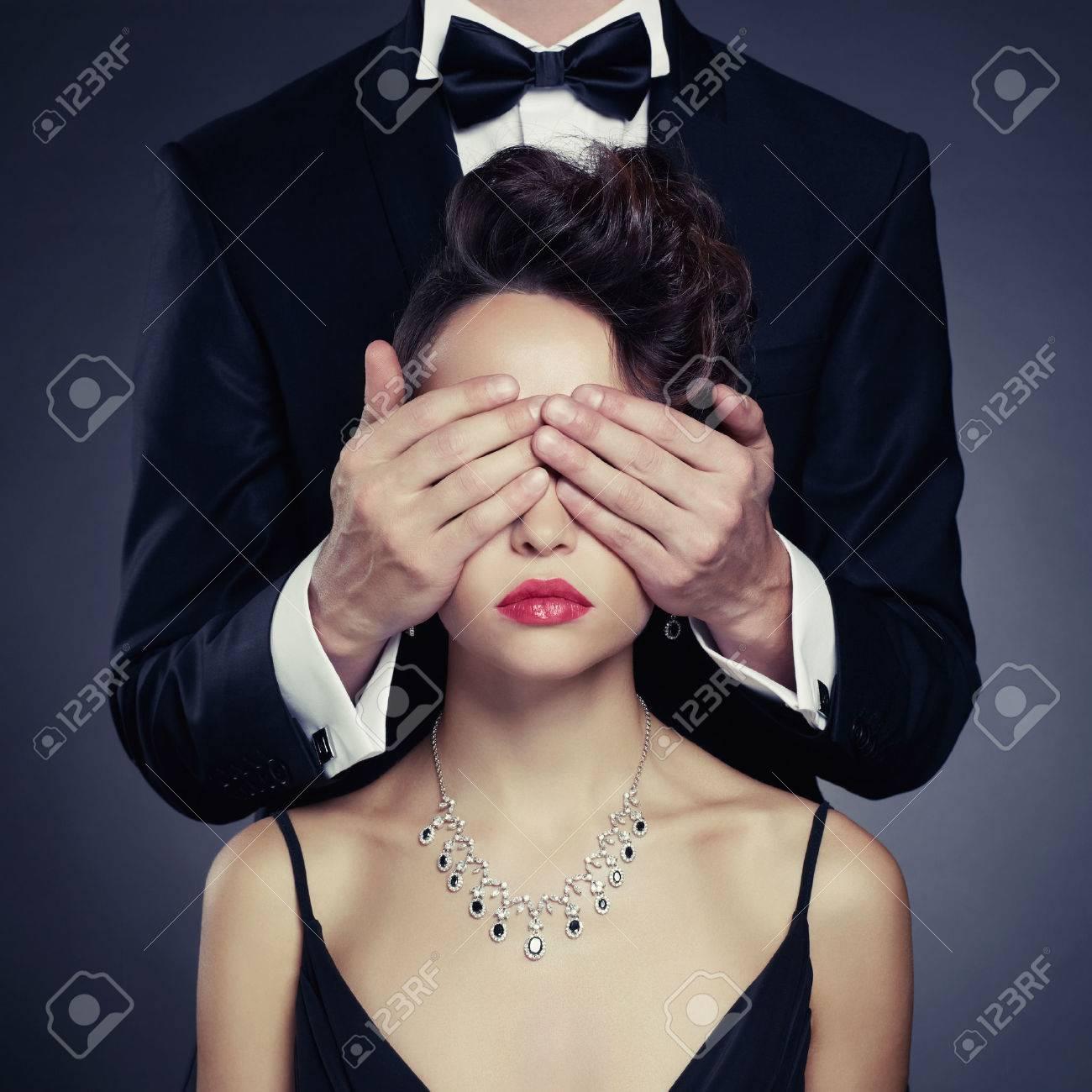 Fashion photo of sexy elegant couple in the tender passion Standard-Bild - 33049071