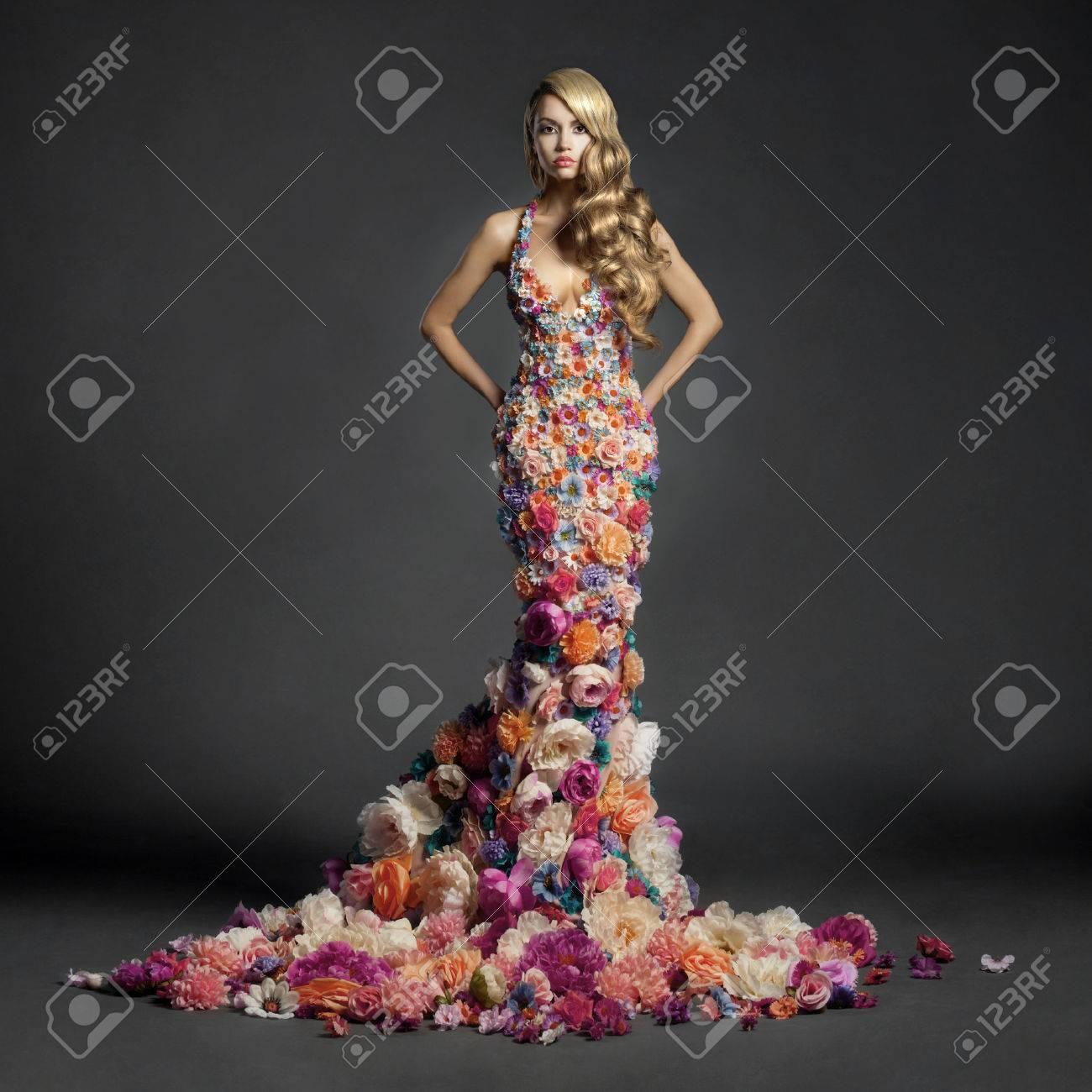 Studio portrait of blooming gorgeous lady in dress of flowers Standard-Bild - 33634380