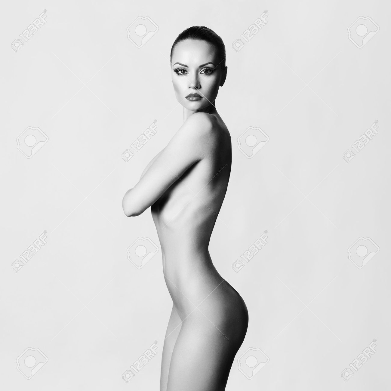 Studio fashion photo of elegant naked lady Standard-Bild - 33856400