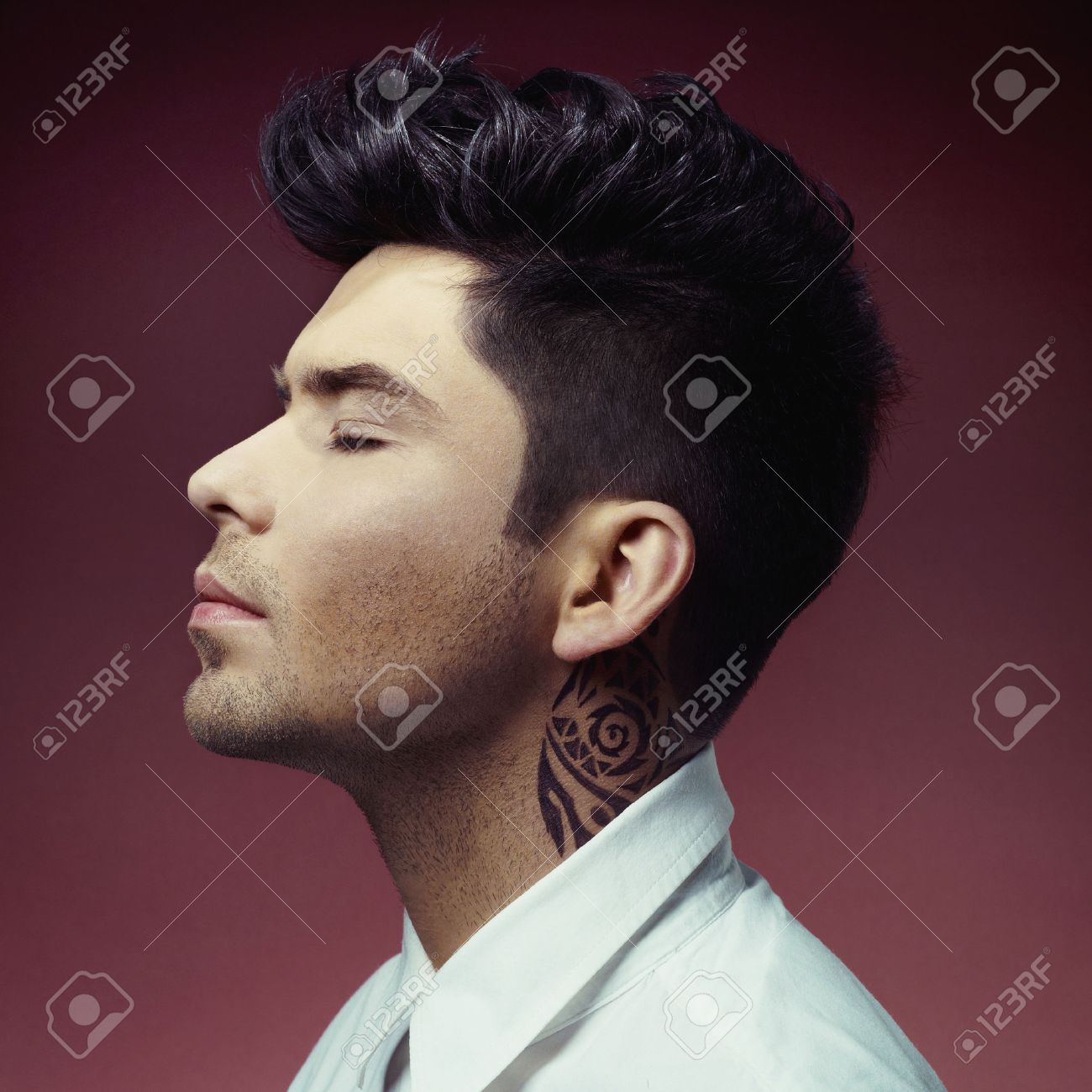 Portrait of handsome man with stylish haircut Standard-Bild - 35194758