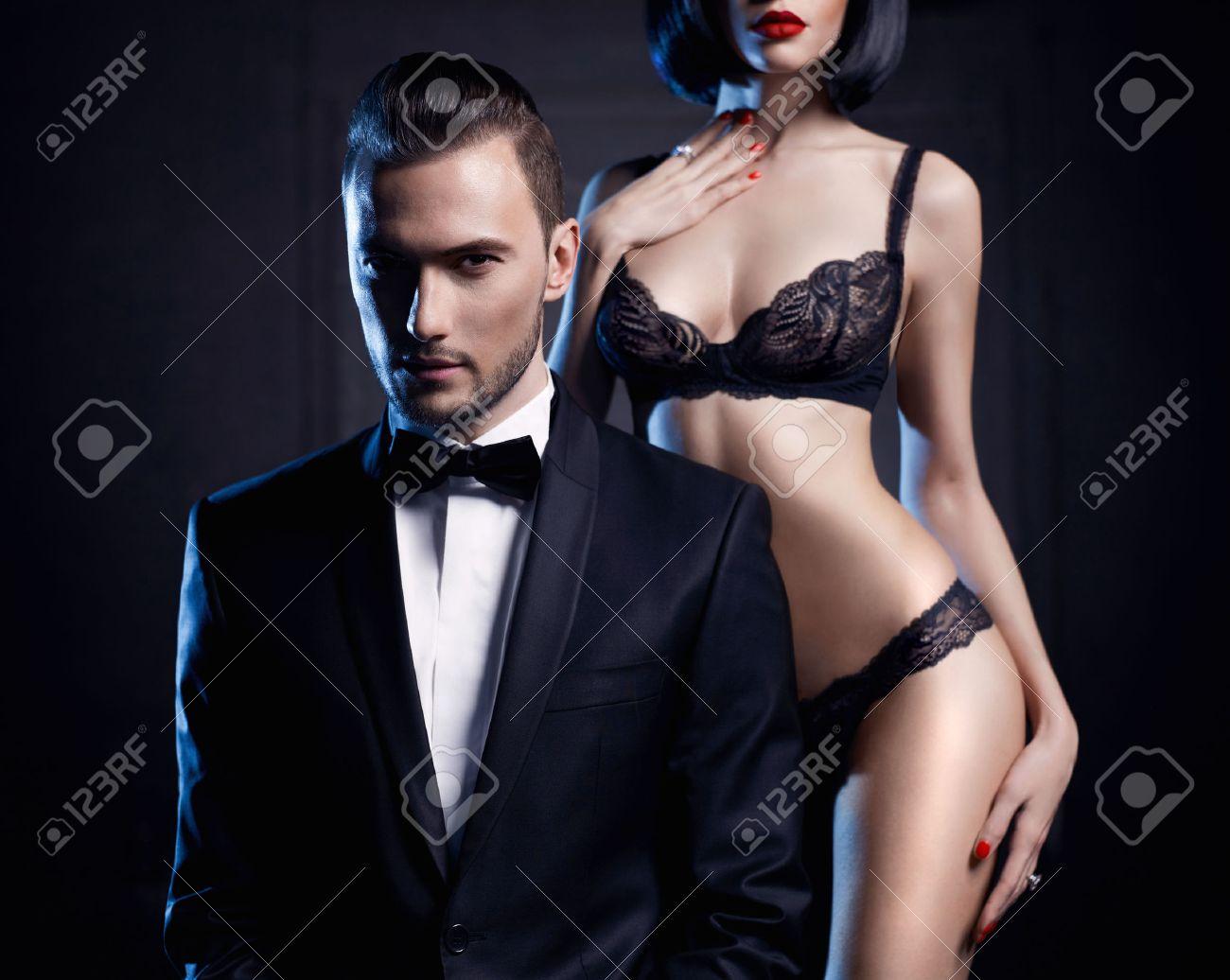 Fashion studio photo of a sensual couple in lingerie and a tuxedo Standard-Bild - 36665794