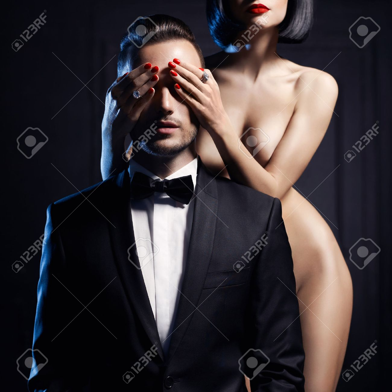 Fashion studio photo of a sensual couple on black background Standard-Bild - 36665797