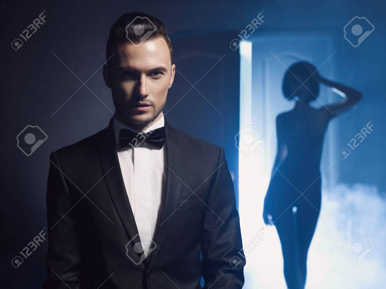 Fashion studio photo of a sensual couple on black background Standard-Bild - 36665799