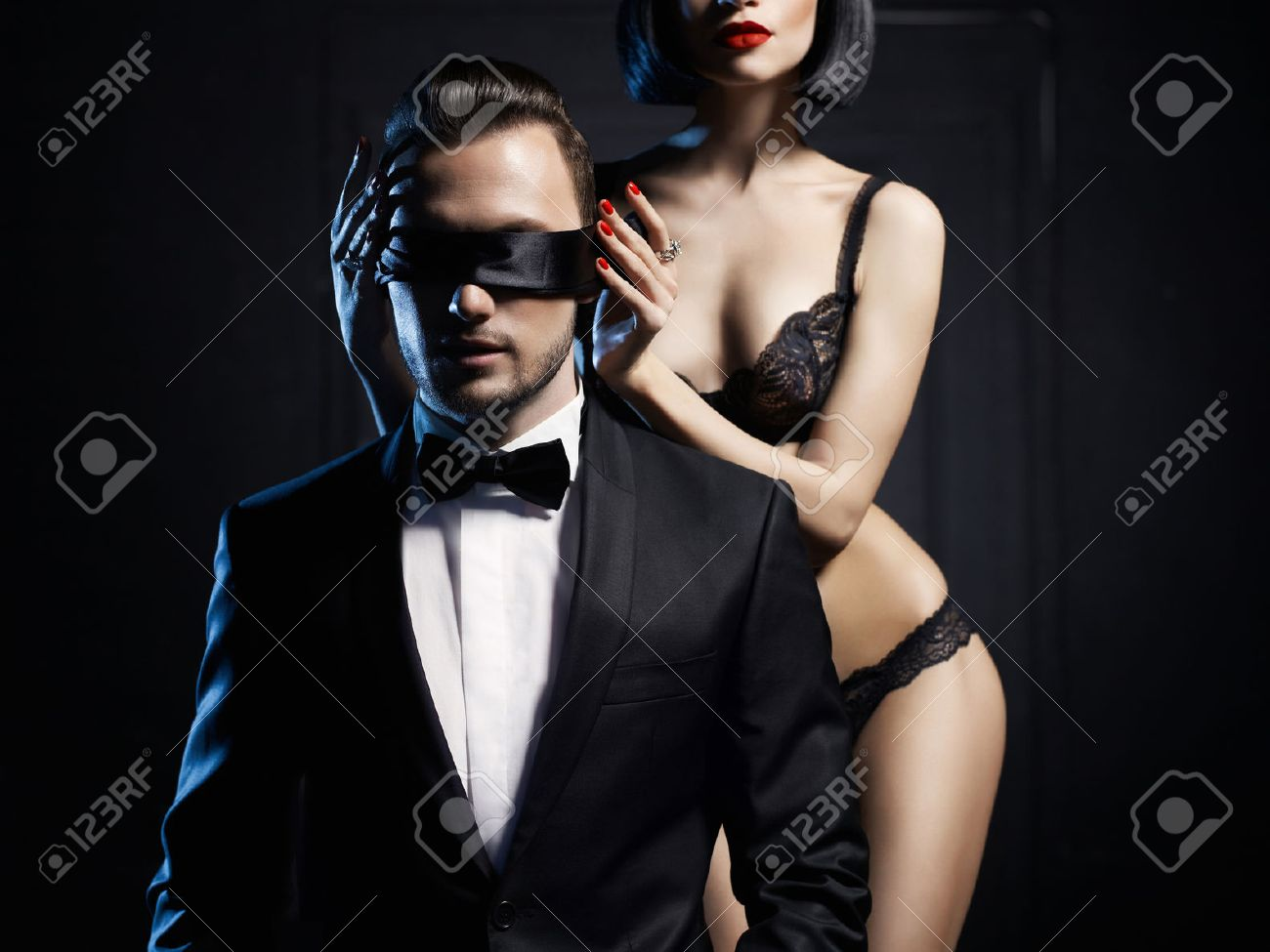Fashion studio photo of a sensual couple in lingerie and a tuxedo Standard-Bild - 36812068