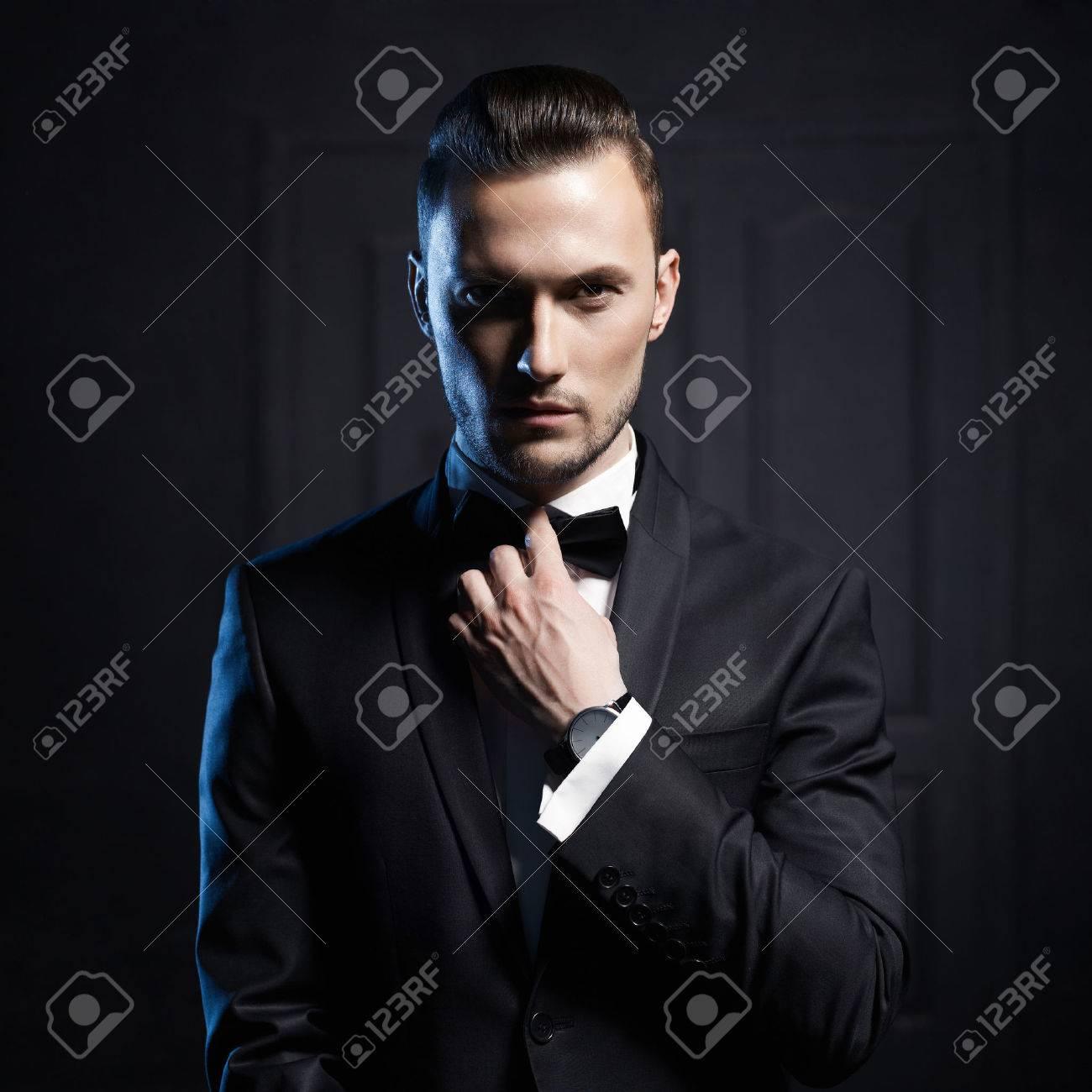 Portrait of handsome stylish man in elegant black suit Standard-Bild - 36812069