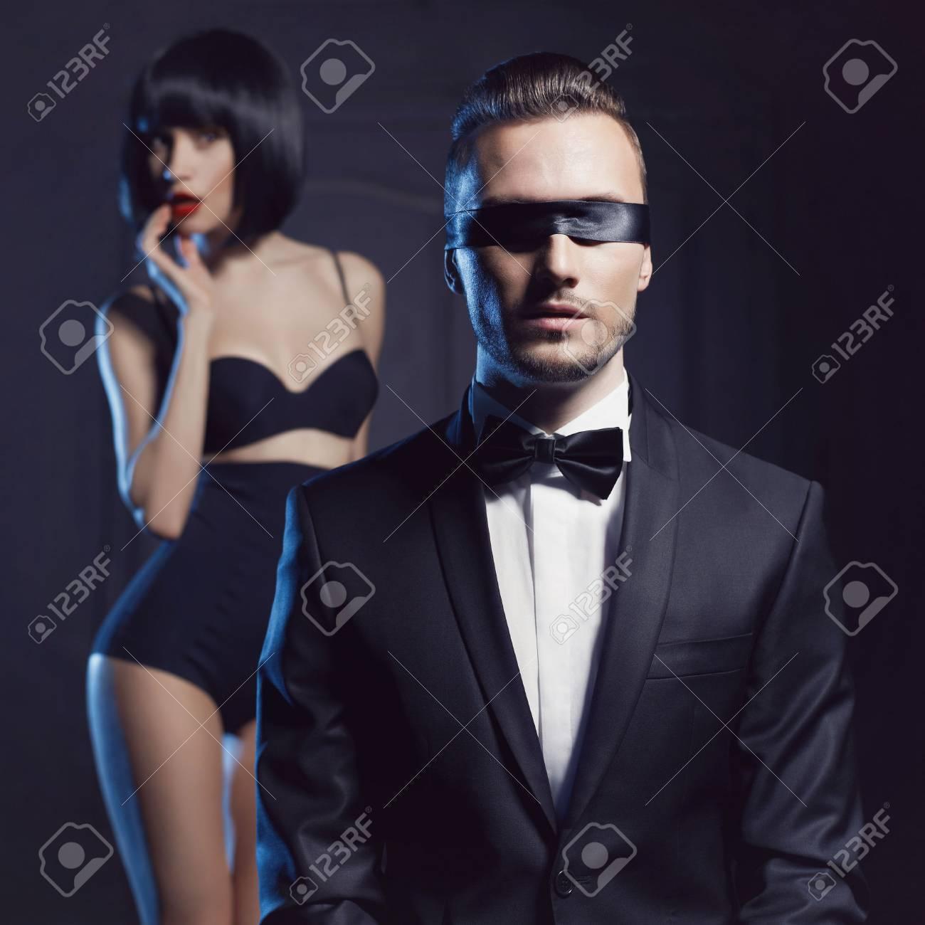 Fashion studio photo of a sensual couple in lingerie and a tuxedo Standard-Bild - 36893801