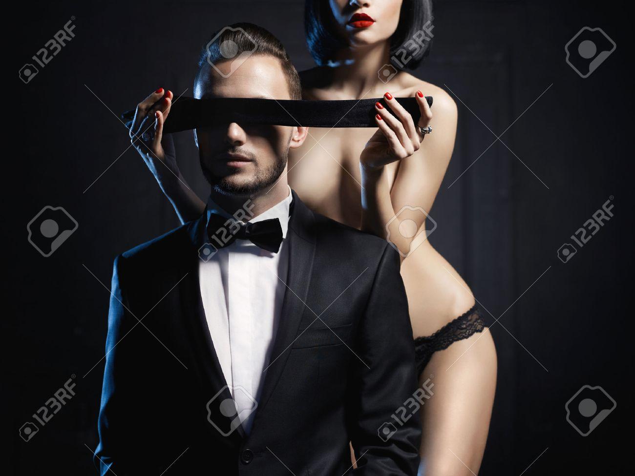Fashion studio photo of a sensual couple in lingerie and a tuxedo Standard-Bild - 37539265