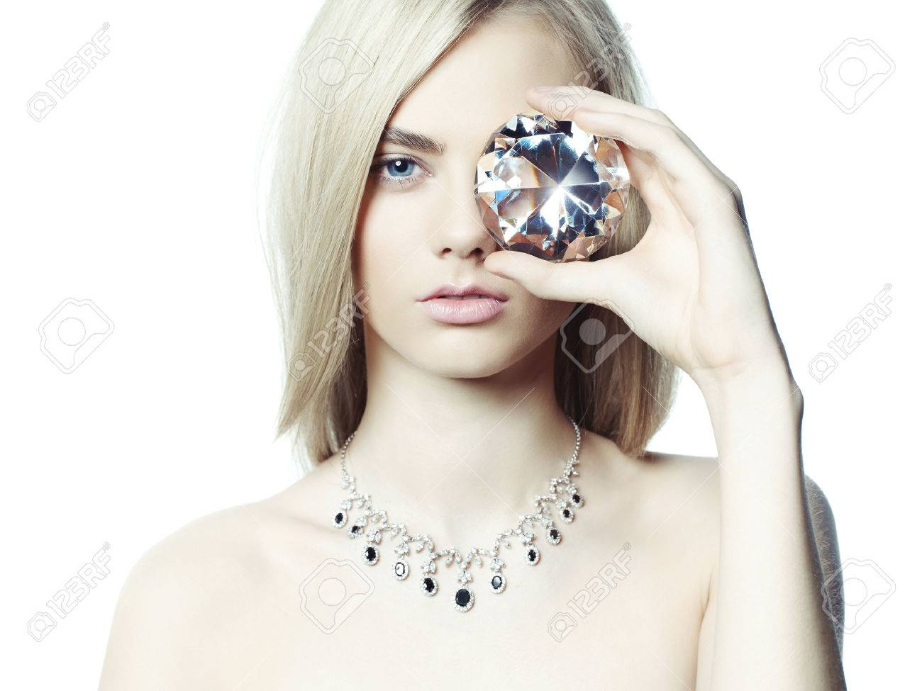 Studio fashion portrait of young beautiful lady in jewelry Standard-Bild - 38121288
