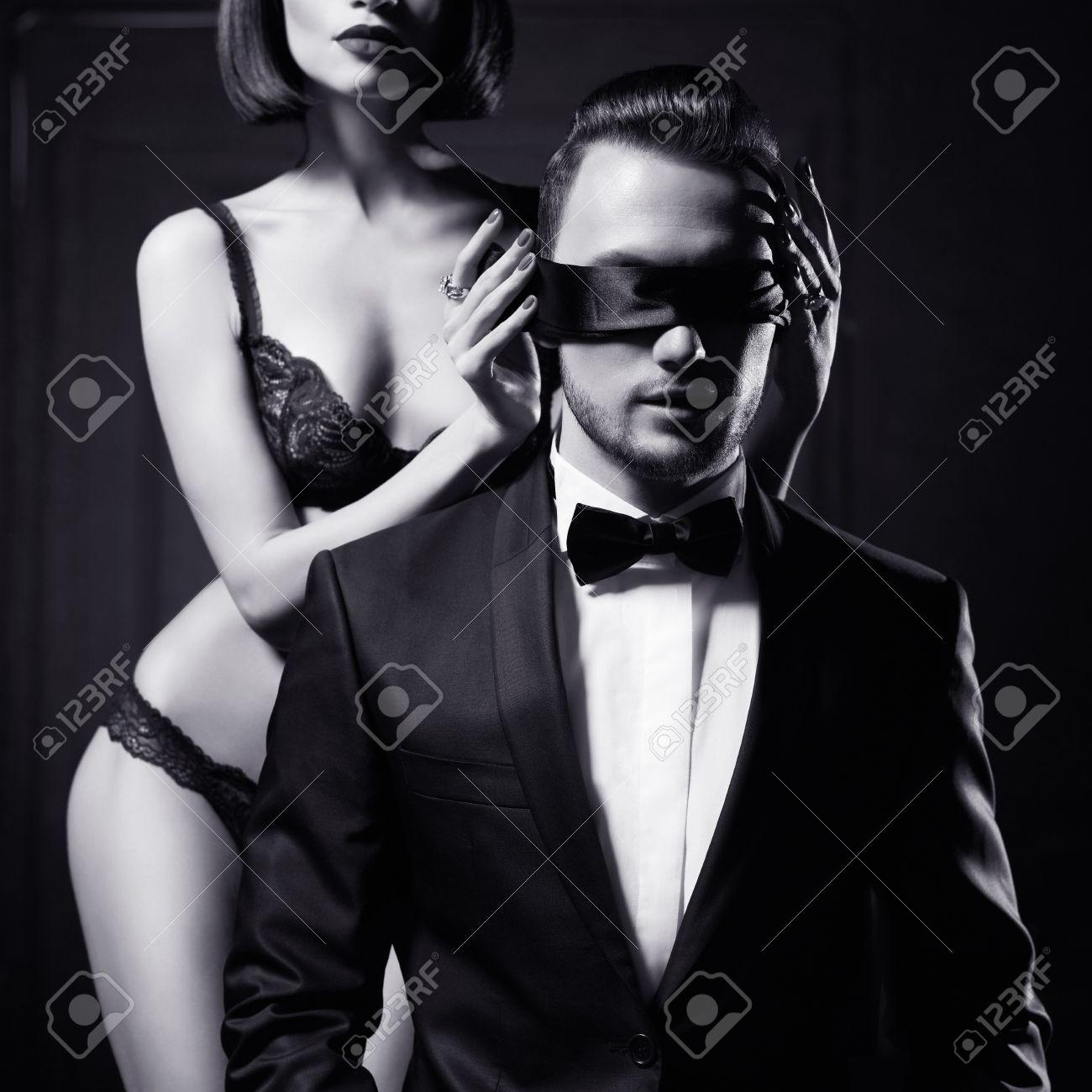 Fashion studio photo of a sensual couple in lingerie and a tuxedo Standard-Bild - 40322499