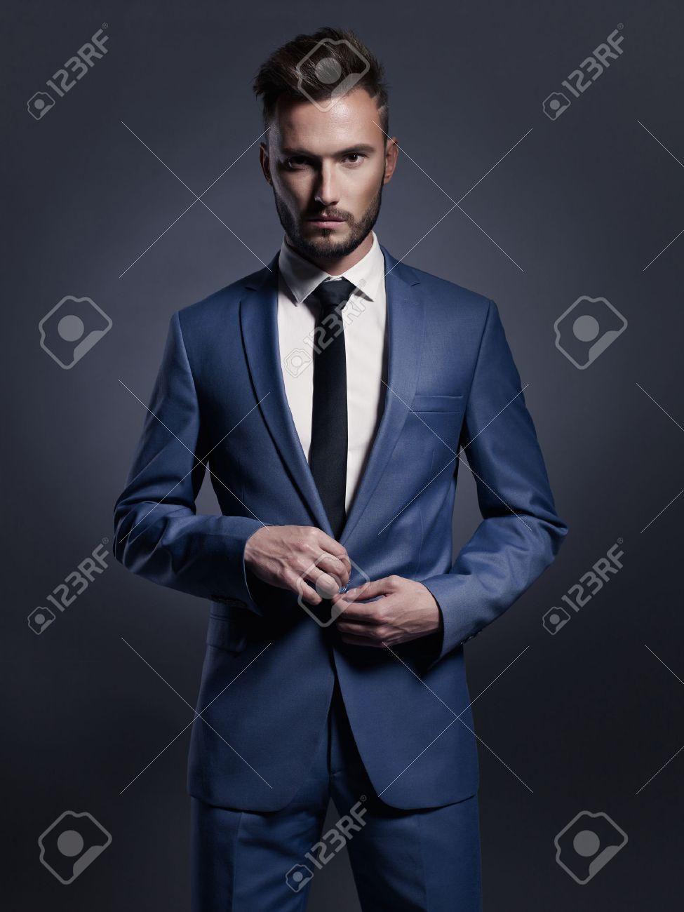 Portrait of handsome stylish man in elegant blue suit Standard-Bild - 46882282