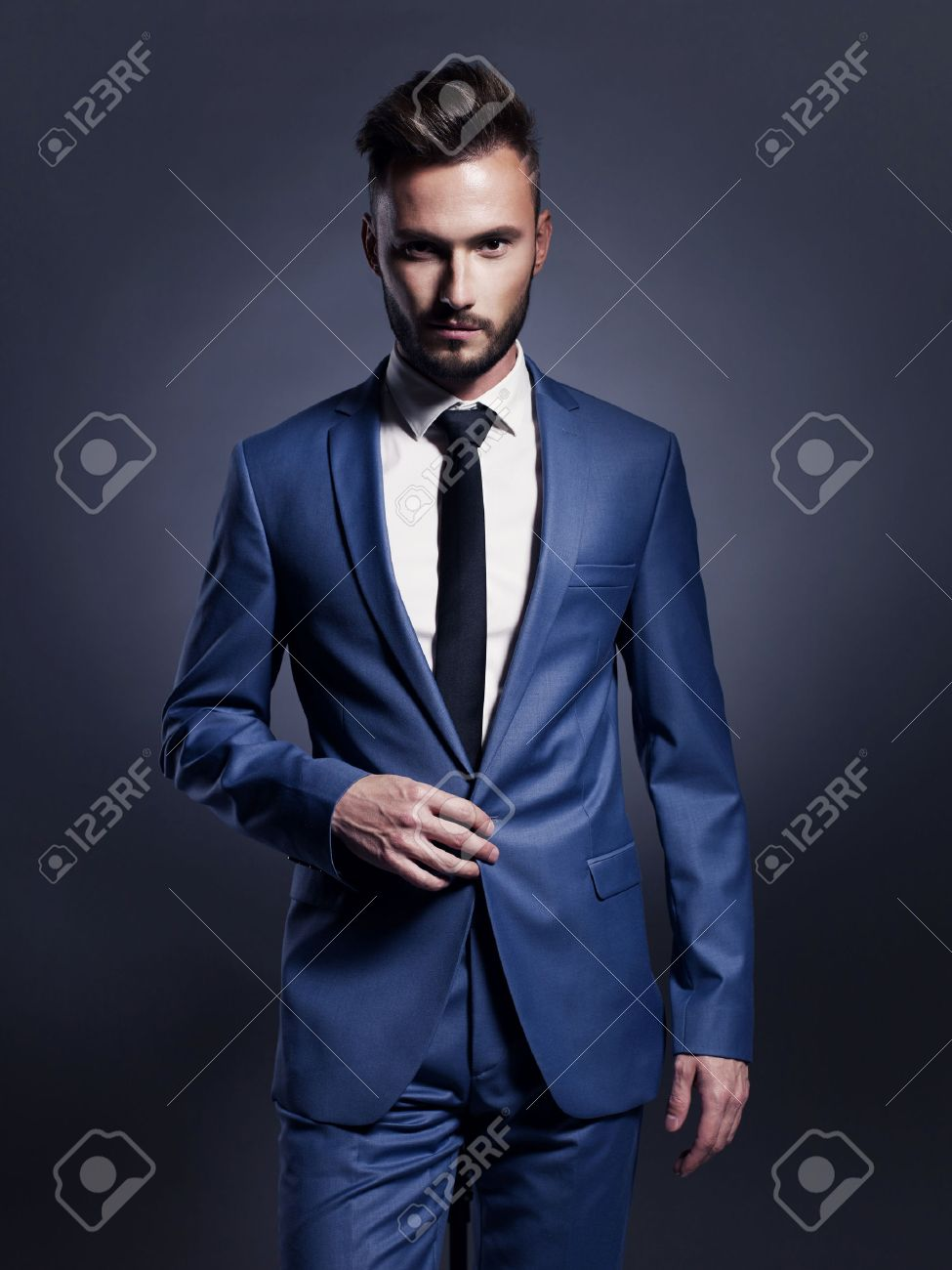 Portrait of handsome stylish man in elegant blue suit Standard-Bild - 46647180